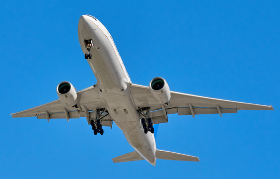 Big modern Boeing jet commercial plane in blue sky including clipping path