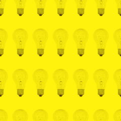 Seamless pattern of light bulbs yellow color