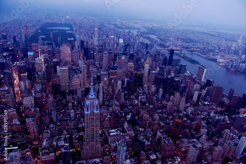 Poster Aerial view of New York city. Dark photo in the evening.