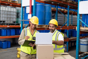 Male and female worker working together in warehouse