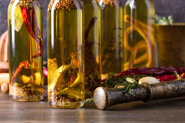 Bottles of olive oil with different spices and herbs.
