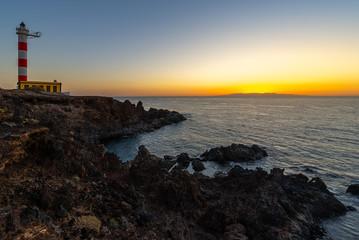 Lighthouse of Punta de Abona at sunrise, Tenerife Island, Spain