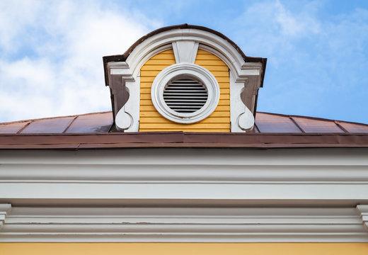 Vintage attic ventilation window on a roof