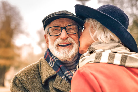 Close up of a happy smiling couple kissing in park