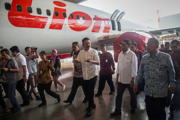 Founder of Lion Air Group Rusdi Kirana walks with Indonesia's Transport Minister Budi Karya Sumadi and Indonesia's Coordinating Minister of Economic Affairs Darmin Nasution, as they inspect the facilities of Batam Aero Technic (BAT)