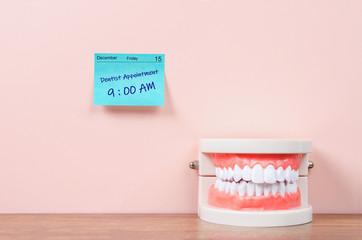 Dentist appointment on sticky note calendar.