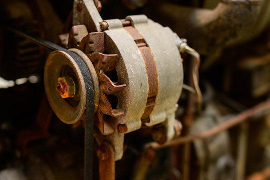 old serpentine drive belt for motor on alternator pulley on automobile engine