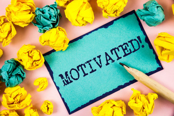 Text sign showing Motivated Motivational Call. Conceptual photo Willing to do something Inspired Confident written Sticky Note paper within Paper Balls plain background Pencil.