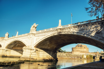 Fotobehang - Embankment of the river at the bridge in the early morning. Rome.