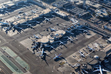 Afternoon aerial view of planes surrounding busy terminals at Los Angeles International Airport on August 16, 2016 in Los Angeles, California, USA.