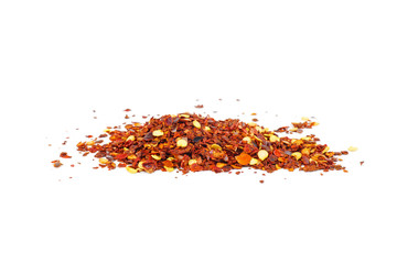 Grinded chili peppers isolated on white background