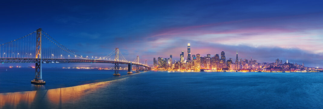 San Francisco Bay Bridge and San Francisco downtown in wide panorama photo
