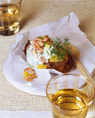 Baked potato with north sea shrimps and sour cream