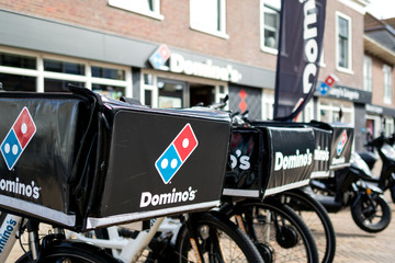 KATWIJK AAN ZEE, THE NETHERLANDS - June 18, 2018: Delivery bikes of Domino's restaurant. Domino's is an American pizza restaurant chain founded in 1960.