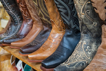 Original western style photograph of cowboy boots all lined up