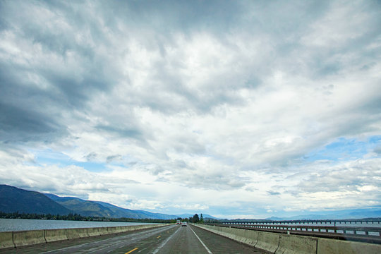 Original photograph of the long road ahead with a vast sky on a road trip