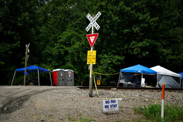 Striking miners have set up a small camp and blockade of railroad tracks to demand unpaid wages from the now-bankrupt mining company BlackJewel, who ran two local coal mines until it ran out of money in July, in Cumberland