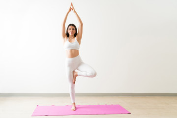Caucasian Female With Tree Pose During Fitness Training