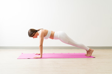 Healthy Living Woman Exercising Plank Yoga Pose