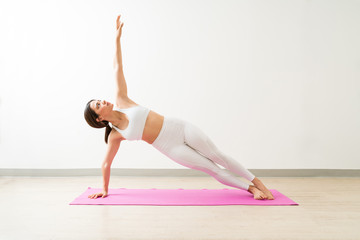 Female Training In Abdominal Exercise On Mat Against Wall