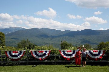 Attendees pose for photos with the White Mountains in the background before the start of a town hall meeting with 2020 Democratic U.S. presidential candidate and U.S. Senator Elizabeth Warren (D-MA) in Franconia