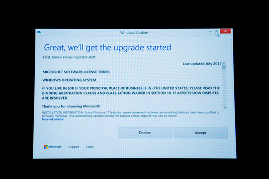 PARIS, FRANCE - JAN 7, 2016: Accept or Decline button on computer screen during Microsoft Windows 10 Upgrade. The new OS operating system offer a better connectivity,