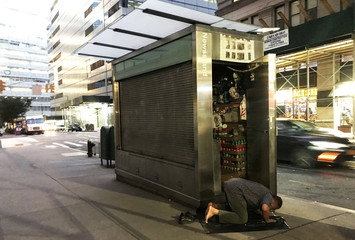 Muslim man prays on the street in the Manhattan borough of New York City