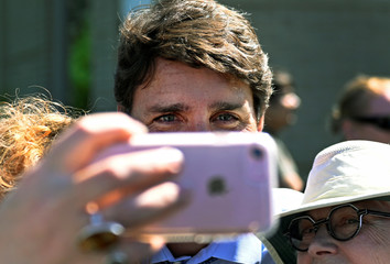 Canada's Prime Minister Justin Trudeau poses for a photo with supporters at the Niagara-on-the Lake Community Centre in Niagara-on-the-Lake