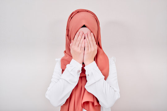 Hijab muslim girl is depressed and sad, she is crying, she has closed or covering face with hands