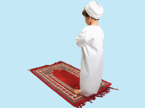 Muslim boy in a dress Praying , isolate background