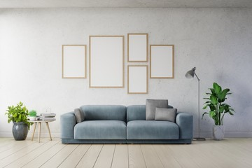 Poster mockup with vertical frames on empty white wall in living room interior ad dark blue sofa.