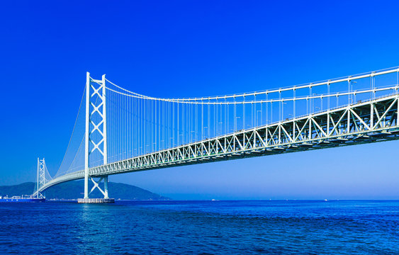 Landscape of Akashi Kaikyo Bridge in the background of blue sky in the summer morning