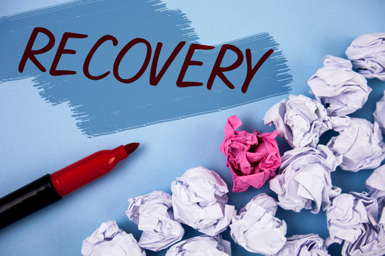 Text sign showing Recovery. Conceptual photo Return to normal state of health Regain possession or control written Painted background Crumpled Paper Balls and Marker next to it.