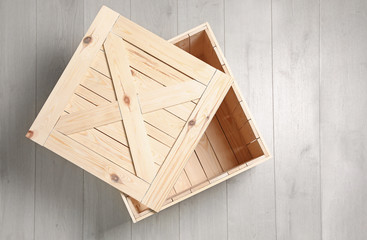 Open wooden crate on floor, top view