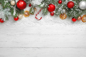 Fotobehang - Christmas decoration with snow on white wooden background, flat lay. Space for text