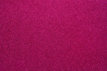 Magenta glitter. Abstract shiny background. Design paper texture for decoration and design of Christmas, New Year or other holiday pictures. Beautiful packaging material.