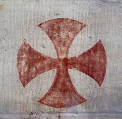 red knights templar cross painted on a wall in a church, close