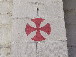 red knights templar cross painted on a wall in a church