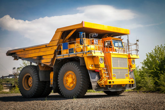 yellow dump truck on the road