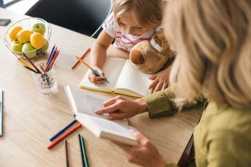 Getting knowledge with caring mother stock photo