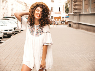 Portrait of beautiful smiling model with afro curls hairstyle dressed in summer hipster white...