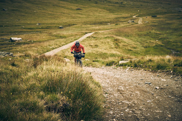 Woman bikepacking on dirt road