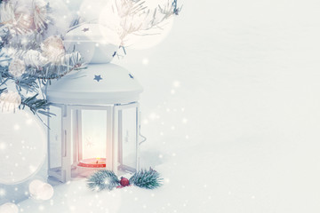 Christmas composition - a lantern with a burning candle and decorations under the Christmas tree, copy space, place for text