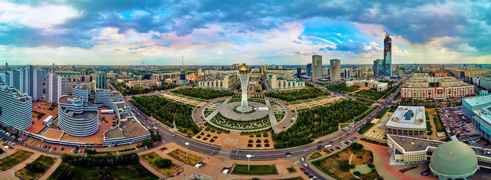 NUR-SULTAN, KAZAKHSTAN (QAZAQSTAN) - August 11, 2019: Beautiful panoramic aerial drone view to Nursultan (Astana) city center with skyscrapers and Baiterek Tower - symbol of Kazakh people freedom