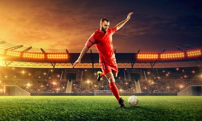 Professional soccer kicks a ball on a soccer stadium. Soccer championship. Dramatic night sky