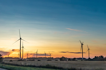 electric wind generators in sunset