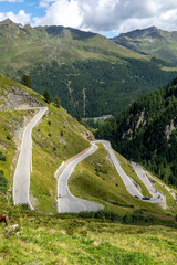 curvy mountain pass road to the Timmelsjoch at the border of Italy and Austria in the Alps