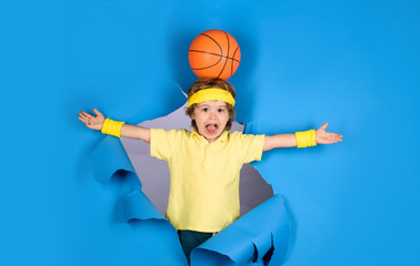Active sport lifestyle. Little basketballer. Surprised child boy holds ball on head. Kid activities. Sports equipment. Basketball training game concept. Small boy playing basketball. Enjoy sport game. Wall mural