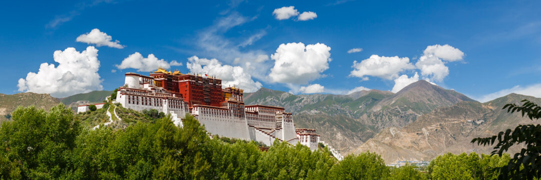 LHASA, TIBET / CHINA - July 31, 2017: Panorama of Potala Palace - home of the Dalai Lama and Unesco World Heritage. Blue sky, clouds. Amazing view of the ancient fortress. Center of Tibetan Buddhism.