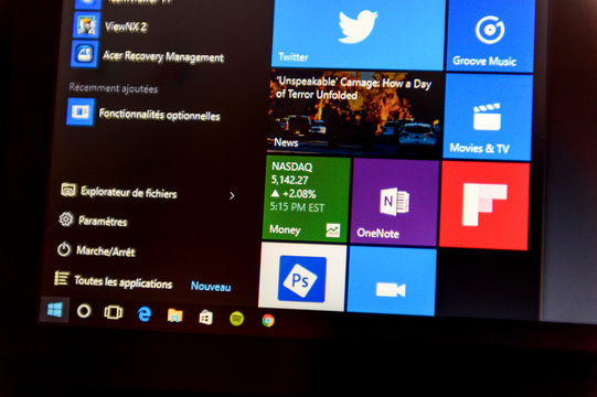 PARIS, FRANCE - DE 16, 2015: Windows 10 main screen with all apps running  in Metro interface tiles